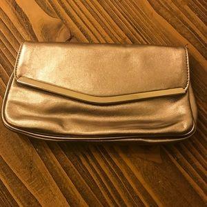 Gold clutch handbag